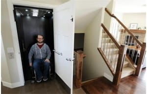 Joel Kleine in his barrier free home with a RAM Crystal Home Elevator